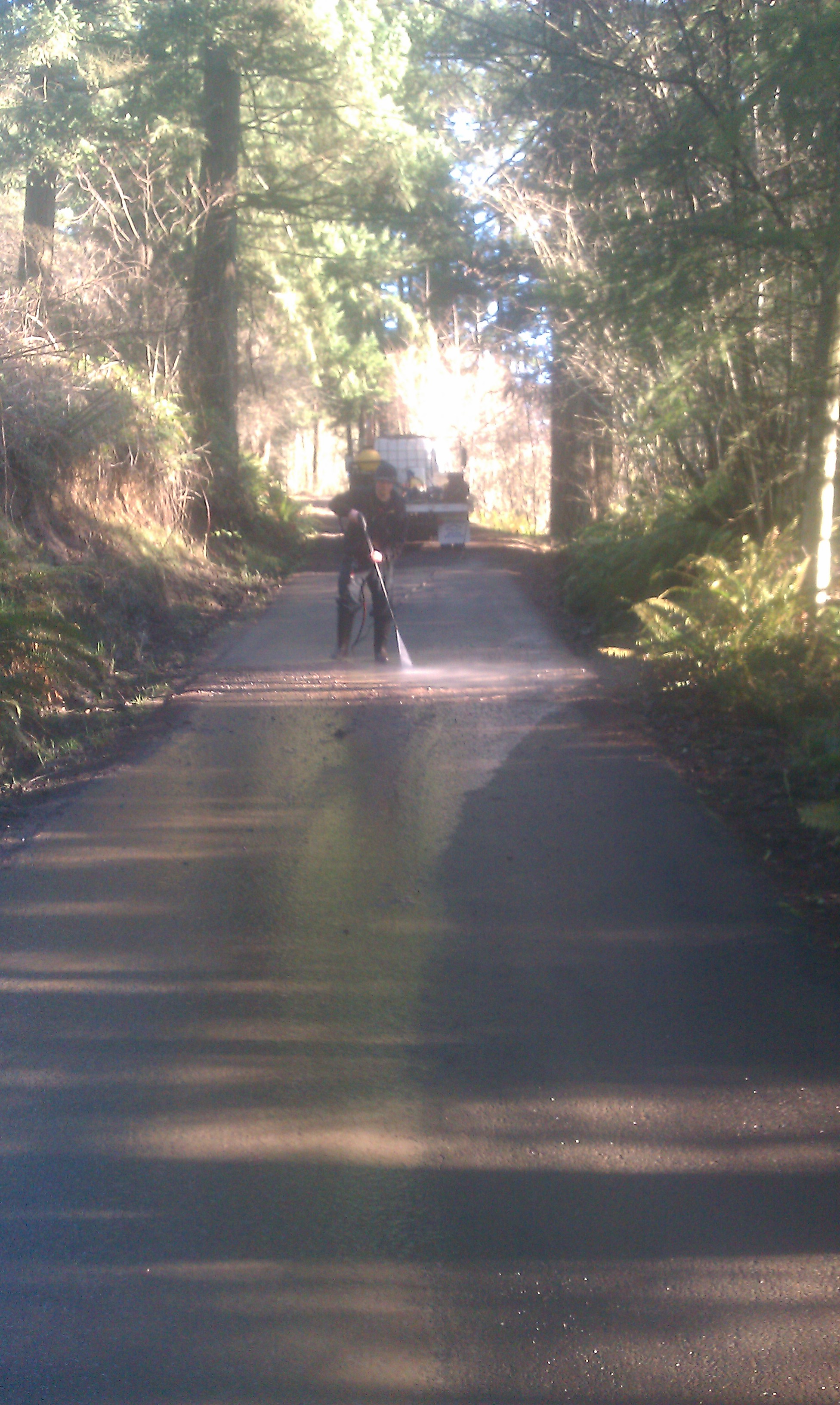 Cleaning roadway - see the difference